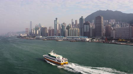 ferry terminal : Hong Kong Aerial v183 Flying low along ferry in Victoria Harbour heading to terminal with cityscape views 217