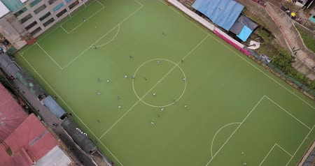 birdseye : Aguas Calientes Peru Aerial v2 Flying low over soccer game looking down