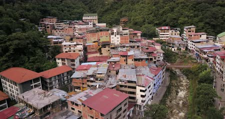 birdseye : Aguas Calientes Peru Aerial v14 Flying low over town and river Stock Footage