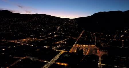 Перу : Cusco Peru Aerial v17 Flying low over town at night with skyline views