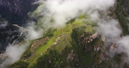régészet : Machu Picchu Peru Aerial v1 Birdseye view flying over ancient ruins