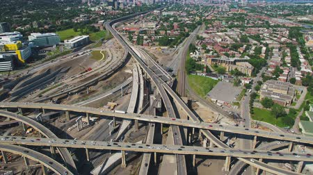скат : Montreal Quebec Aerial v1 Flying over large freeway interchange panning up to cityscape