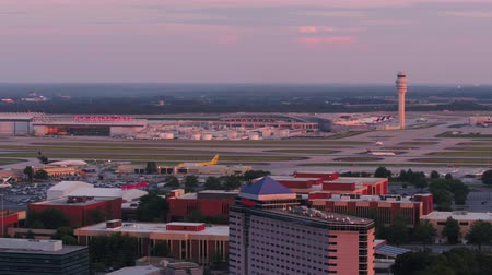 concourse : Atlanta Aerial v290 Closeup flying low besides Hartsfield-Jackson airport panning at sunset 617 Stock Footage