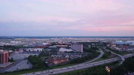 to take : Atlanta Aerial v296 Flying low backwards away from Hartsfield-Jackson airport at sunset 617