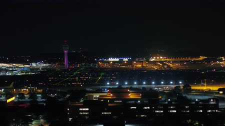 concourse : Atlanta Aerial v303 Closeup flying low besides Hartsfield-Jackson airport panning at night 617