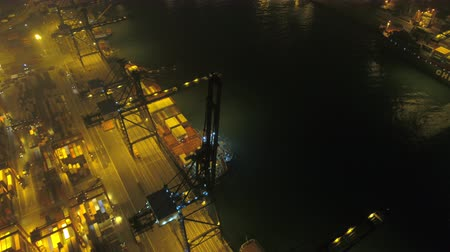 tesisler : Hong Kong Aerial v197 Flying low over large shipyard terminal panning at night 217