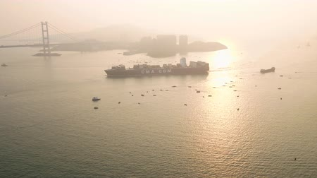 navio : Hong Kong Aerial v199 Flying low out to large cargo ship passing by at sunset 217