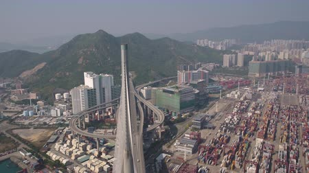 süspansiyon : Hong Kong Aerial v202 Flying over Stonecutters Bridge and pole tower panning down 217 Stok Video