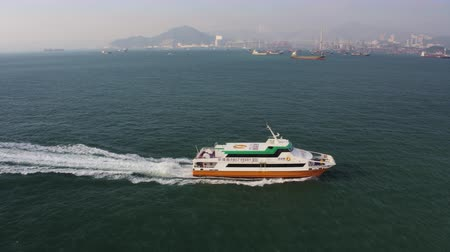 ferry terminal : Hong Kong Aerial v222 Flying low around small fast ferry headed to city 217