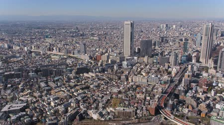 moscas : Japan Tokyo Aerial v90 Flying over Yoyogi park panning with cityscape views