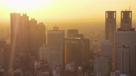 cocoon : Japan Tokyo Aerial v99 Flying low across downtown Shinjuku cityscape at sunset 217