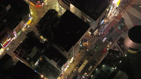 neon lights : Japan Tokyo Aerial v102 Birdseye view flying low around famous Shibuya intersection area night 217