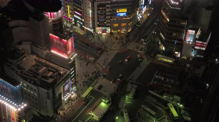 tokyo station : Japan Tokyo Aerial v103 Birdseye view flying low around famous Shibuya intersection area night 217