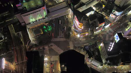 tokyo station : Japan Tokyo Aerial v107 Birdseye view flying low around famous Shibuya intersection area night 217 Stock Footage