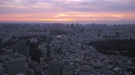shibuya : Japan Tokyo Aerial v112 Flying over Shinjuku area with cityscape views at sunriseÊ