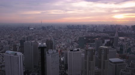 tokyo government : Japan Tokyo Aerial v113 Flying over downtown Shinjuku panning with cityscape views sunriseÊ