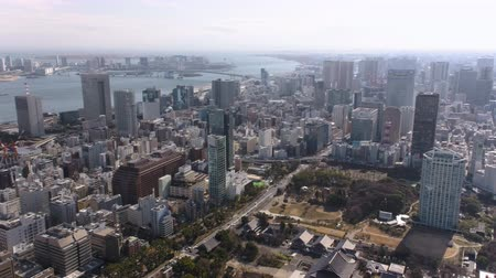 chuo city : Japan Tokyo Aerial v120 Flying low over Minato area panning with cityscape views 217