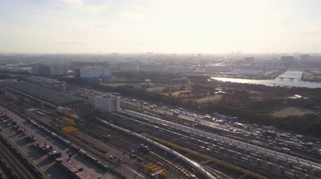 tesisler : Japan Tokyo Aerial v129 Flying low over bullet train terminal area with cityscape views Stok Video