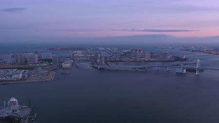 chuo city : Japan Tokyo Aerial v139 Flying over harbor panning at dusk with cityscape industrial views