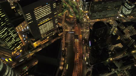 chuo city : Japan Tokyo Aerial v149 Birdseye view flying low over Ginza area night 217 Stock Footage