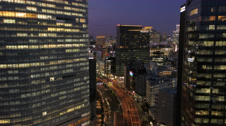 chuo city : Japan Tokyo Aerial v146 Flying low over Hamarikyu park with Ginza cityscape views dusk 217