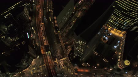 looking down : Japan Tokyo Aerial v150 Birdseye view flying low over Ginza area night
