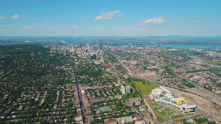 склон холма : Montreal Quebec Aerial v85 Flying high panning with full cityscape views