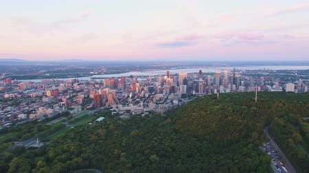 přešel : Montreal Quebec Aerial v90 Flying over Mount Royal park panning at sunset with cityscape views