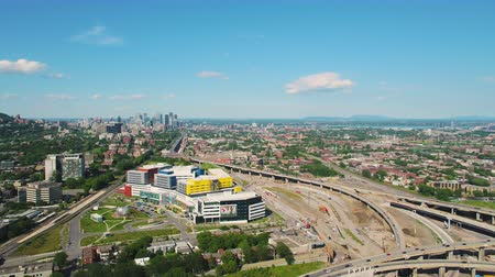 csomópont : Montreal Quebec Aerial v88 Flying low near freeway interchange and hospital panning cityscape views 717