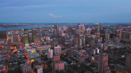 Montreal Quebec Aerial v104 Flying low across downtown at dusk with cityscape views 717