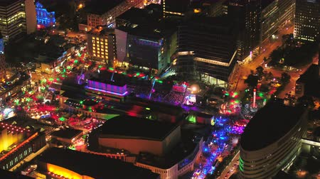 Montreal Quebec Aerial v110 Birdseye view flying low around summer festival downtown at night