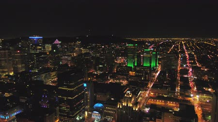 Montreal Quebec Aerial v114 Flying over downtown waterfront area panning with cityscape views at night Stok Video