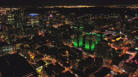 Montreal Quebec Aerial v115 Flying low over downtown at night panning down cityscape views 717 Stok Video