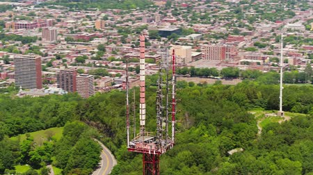 Montreal Quebec Aerial v120 Closeup flying around radio tower with cityscape and park views