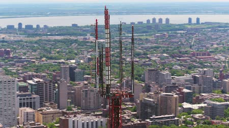 Montreal Quebec Aerial v121 Closeup flying around radio tower with cityscape and park views 717