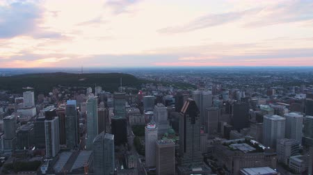 Montreal Quebec Aerial v134 Flying over downtown panning with cityscape views sunset 717 Stok Video