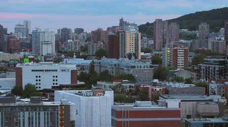 Montreal Quebec Aerial v143 Flying low across downtown with cityscape views at dusk 717 Stok Video