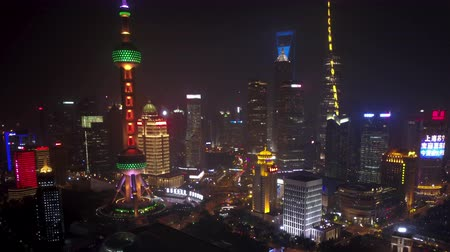 pearl : Shanghai China Aerial Time Lapse Night v2 Flying birdseye view of busy financial district along river.