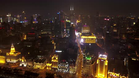 Shanghai China Aerial Time Lapse Night v4 Flying along river with busy cityscape views.
