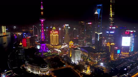 Shanghai China Aerial Time Lapse Night v5 Flying from high to low into busy financial district. Stok Video