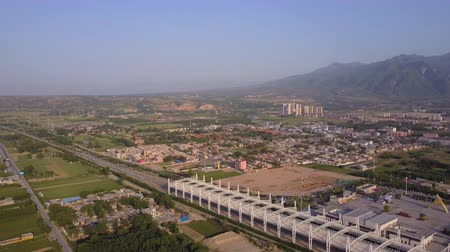 shaanxi : China Huayin Aerial v4 Flying low over high speed train station with city mountain views 517