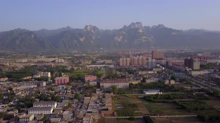 shaanxi : China Huayin Aerial v3 Flying low with city mountain views 517