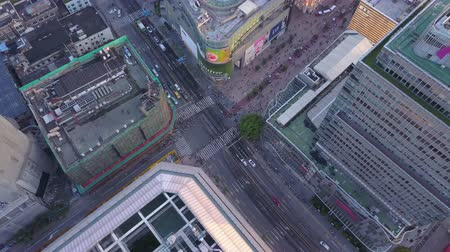 birdseye : China Shanghai Aerial v28 Birdseye flying around Bund walking street intersection 517 Stock Footage