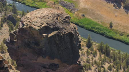 renowned : Oregon Aerial v18 Birdseye closeup view flying low around Monkey Face at Smith Rock park 817 Stock Footage
