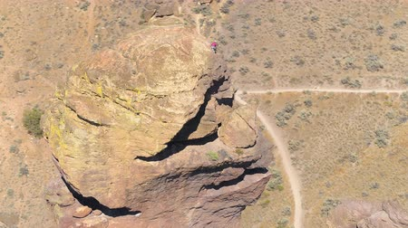 renowned : Oregon Aerial v19 Birdseye closeup view flying low around Monkey Face at Smith Rock park 817 Stock Footage