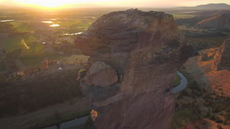 renowned : Oregon Aerial v20 Closeup view flying low around Monkey Face at Smith Rock park sunset 817