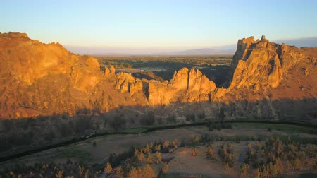 renowned : Oregon Aerial v22 Flying low around Smith Rock park area sunset 817 Stock Footage