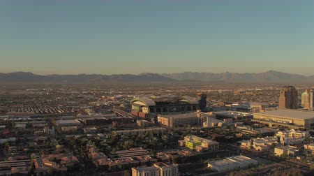 metropolitan area : Phoenix Arizona Aerial v1 Flying low over downtown area panning sunset cityscape 916