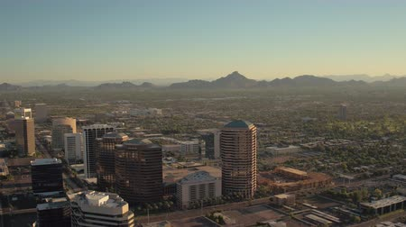 anka kuşu : Phoenix Arizona Aerial v4 Flying low over downtown area panning sunset cityscape 916