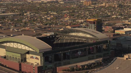 metropolitan area : Phoenix Arizona Aerial v9 Birdseye view flying low around stadiums sunset 916